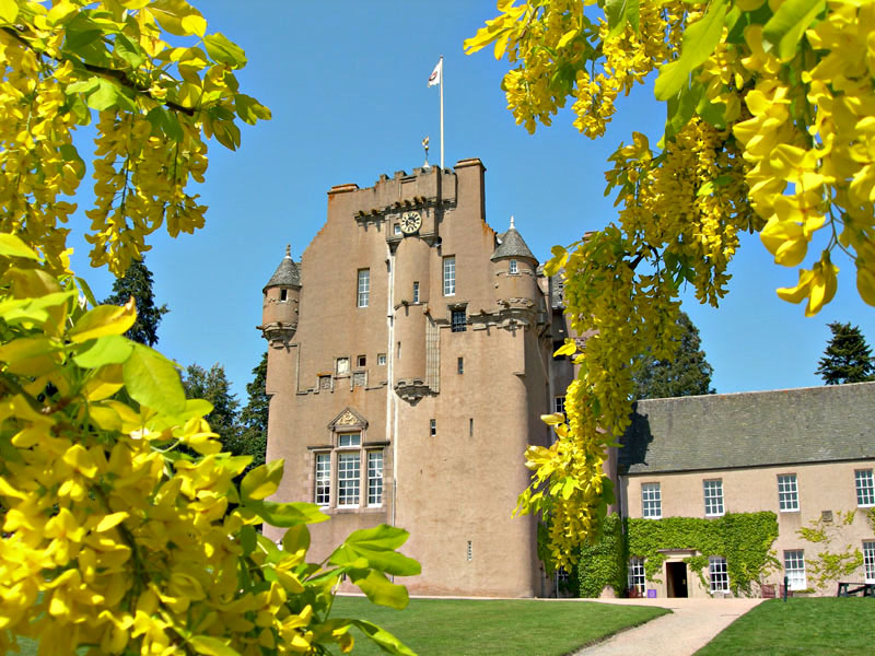 Crathes Castle with laburnum flowers in the foreground  © 2006 Scotiana