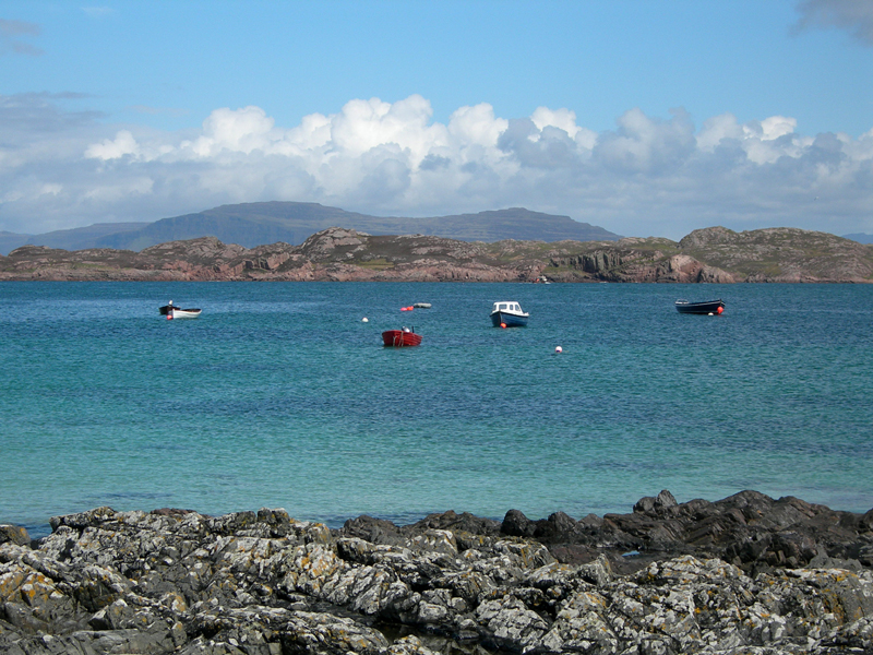 Blue waters and colourful boats on Iona island © 2006 Scotiana