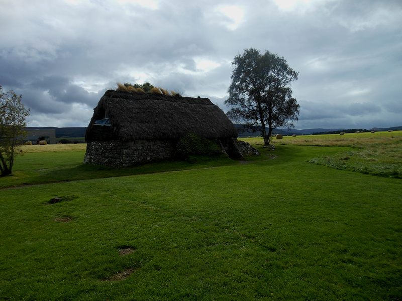 Culloden Old Leanach cottage surrounded by haystacks © 2012 Scotiana