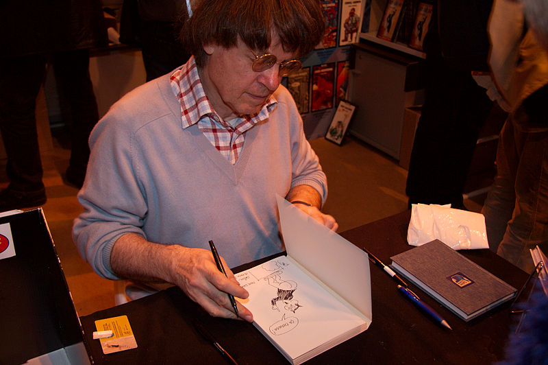 Cabu dedicating books at Salon du Livre 2008