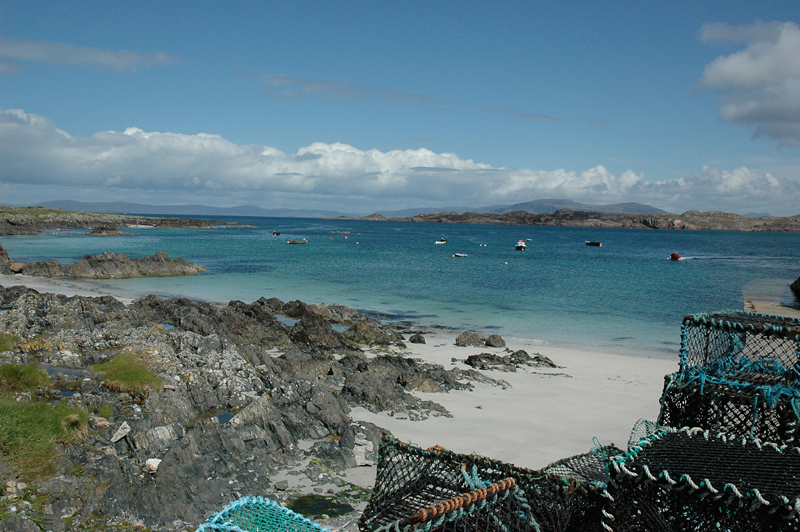 Iona beach turquoise blue waters and lobster pots © 2006 Scotiana