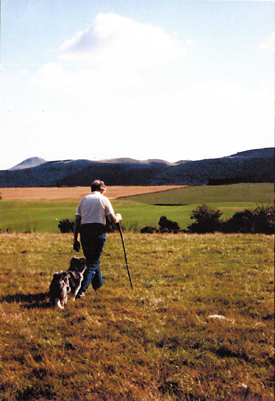 George and his border collie walking in the fields © Scotiana