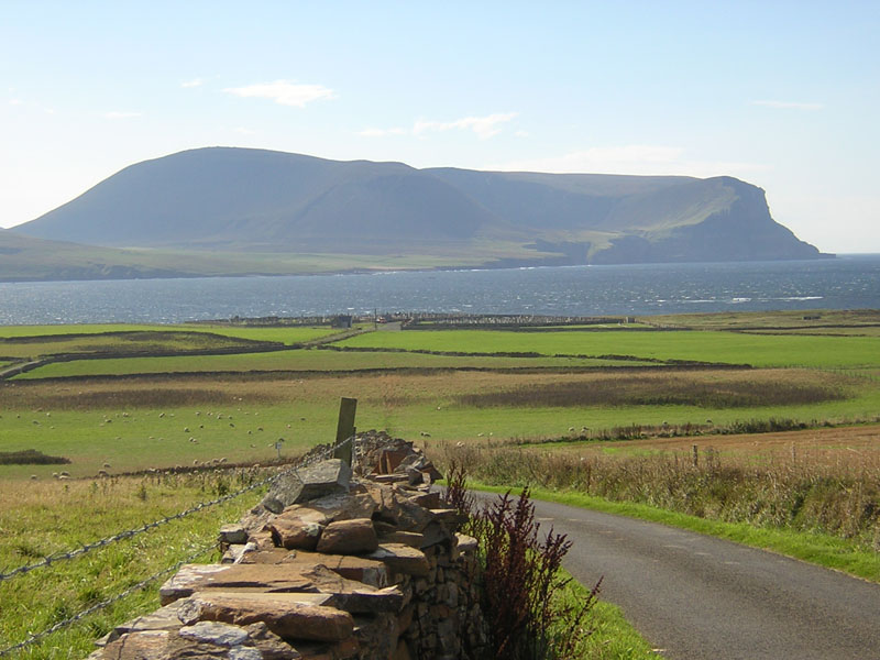 Stromness road to Warbeth cemetery with Hoy in the background © 2003 Scotiana