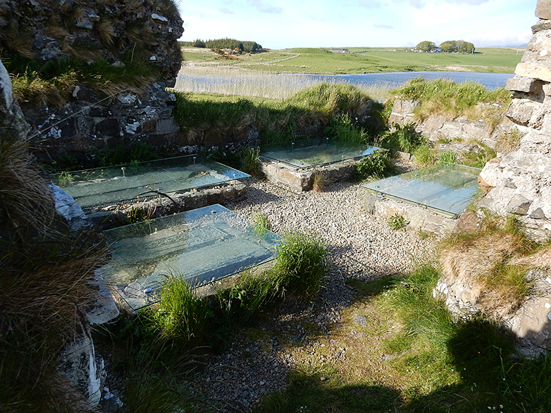 Islay Finlaggan grave slabs in chapel © 2015 Scotiana