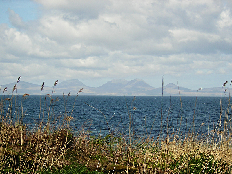 View of the Paps of Jura from the Kintyre road © 2004 Scotiana