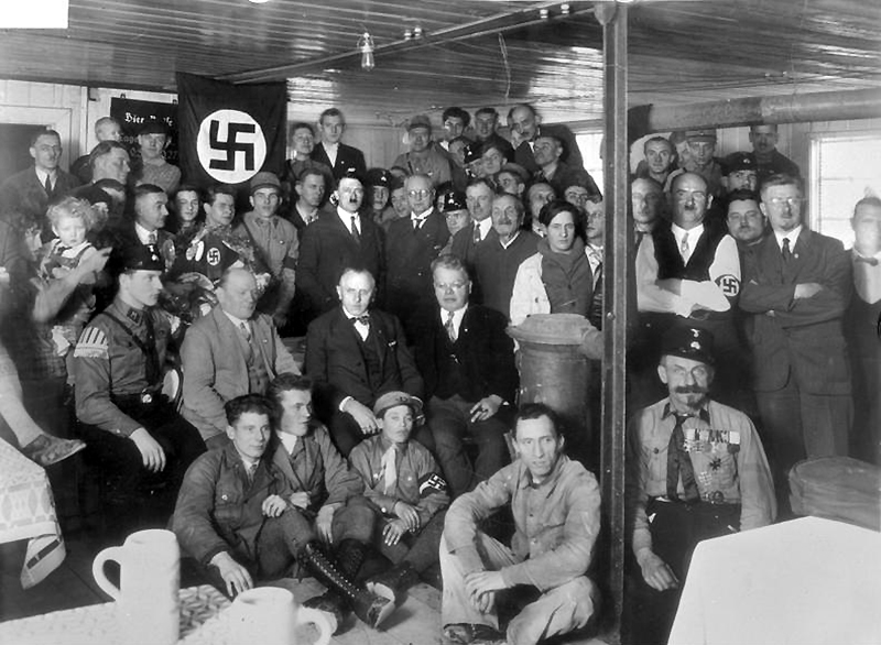 Hitler with Nazi Party members in 1930