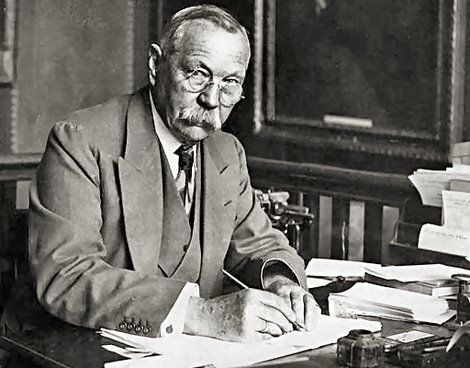 Sir Arthur Conan Doyle writing at his desk