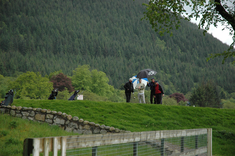 Playing golf in the rain Ballachulish, Lochaber, Highland  © 2006 Scotiana