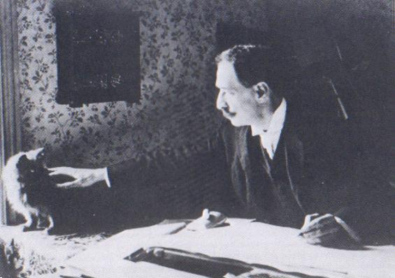 Louis Wain at his drawing table around 1890