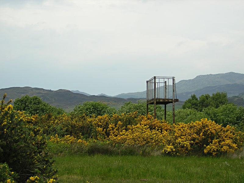Eilean Donan Castle gorse and cinema scaffolding © 2004 Scotiana