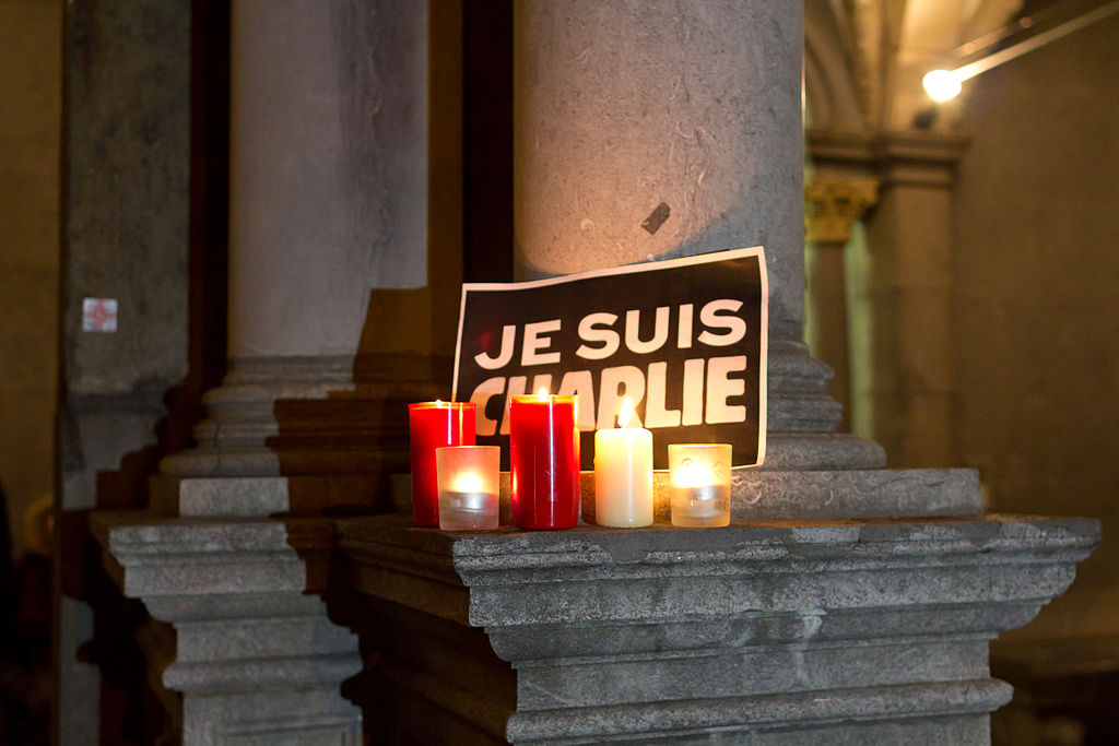 Cologne: candles shining in the night for the victims of Charlie Hebdo shooting