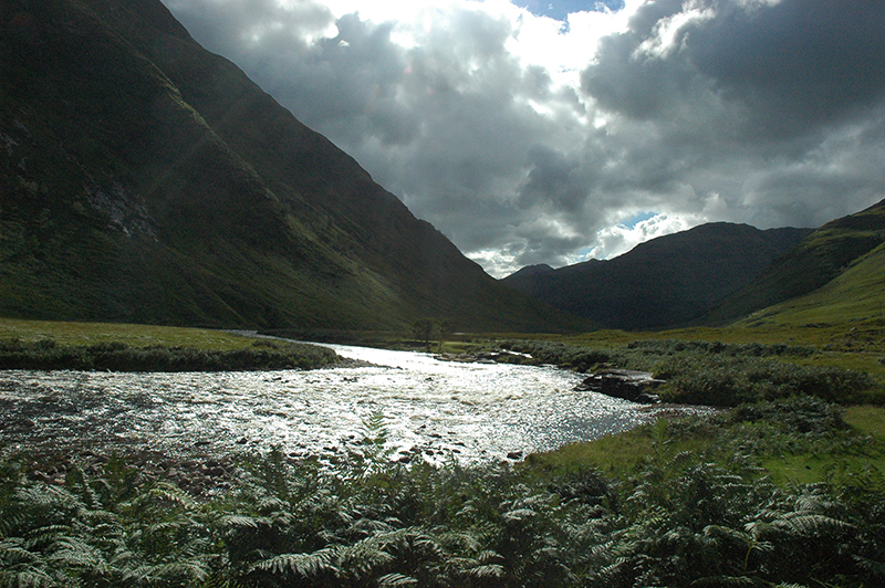 The dark mountains of Glen Coe and luminous reflections of the river Coe © 2007 Scotiana